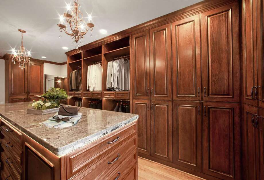 This closet remodel is by Keechi Creek Builders. Photo: B-Rad Studios, Owner / 2010