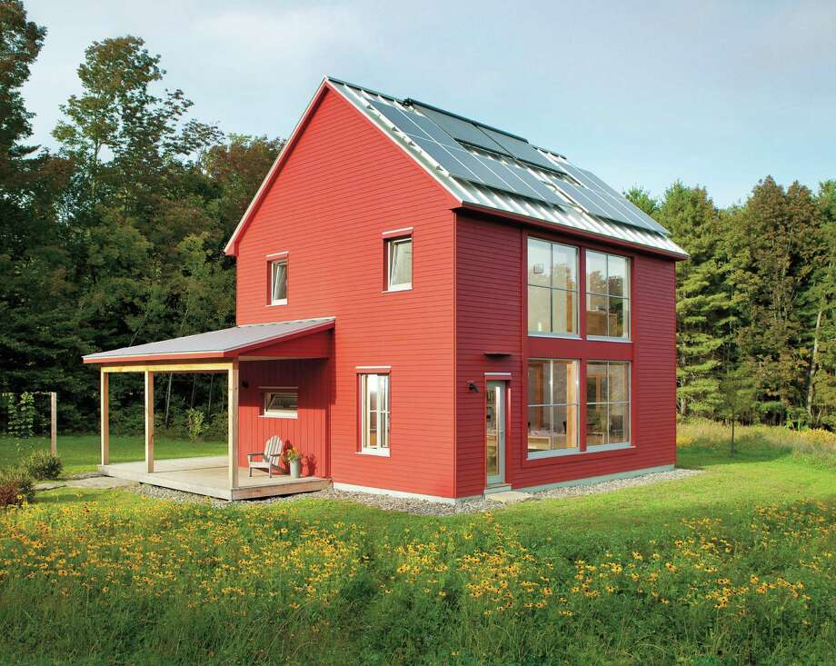 This super-energy efficient, modestly sized, 1,500-square-foot house in Belfast, Maine, clearly illustrates energy efficiency and big windows are compatible. The prefab components are the structural insulated panels that were used for the building envelope. The HERS rating is 20. Photo: Ninja