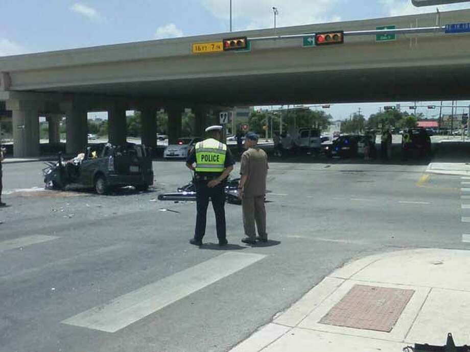 Police at scene of a major crash on the westbound lanes of Loop 410 at Perrin Beitel Road about 12:30 p.m. on Friday, June 21, 2013. Photo: Jennifer Luna/ Express-News