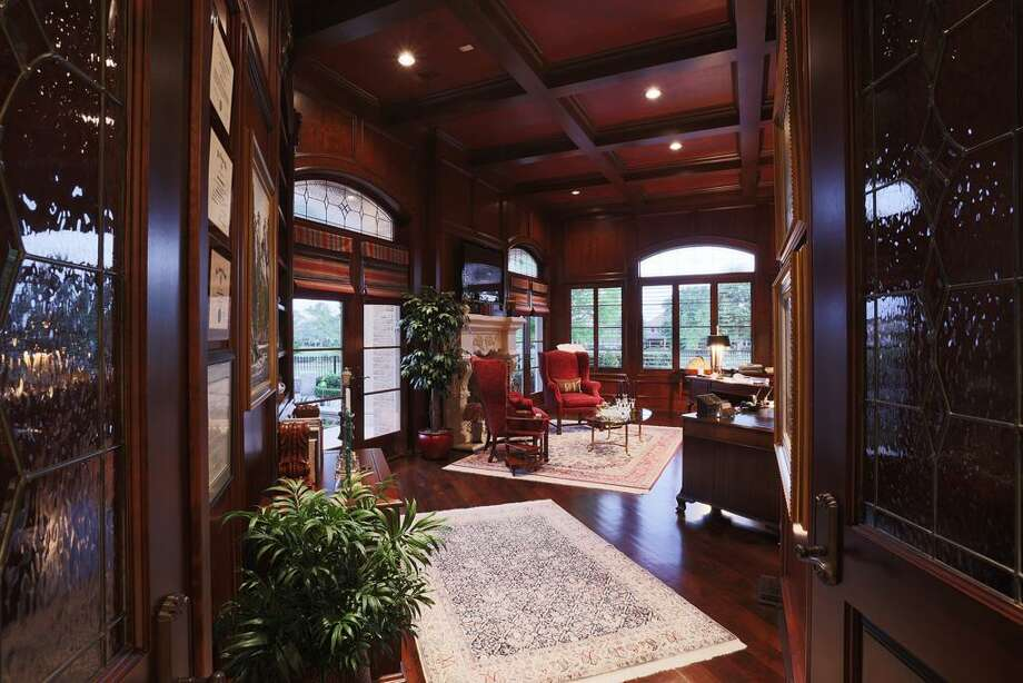 Entrance to the Study has double leaded glass doors. This room has the awesome golf course view + another fireplace & cherry hardwood floors with enough room for 2 desks+ sitting area.