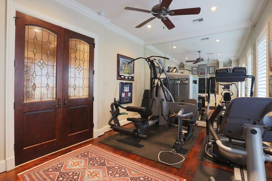 Exercise Room with double leaded glass doors & hardwood floors with another breathtaking view.of the golf course.
