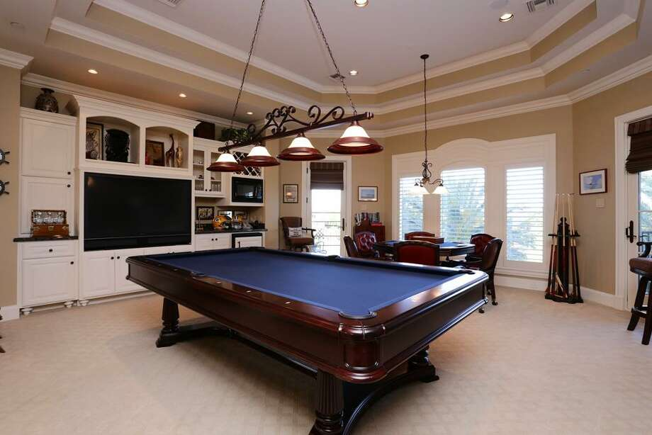 Game room measures 21x19 with a balcony over looking pool & the awesome view. There is a beverage cooler, microwave & tons of built ins here.