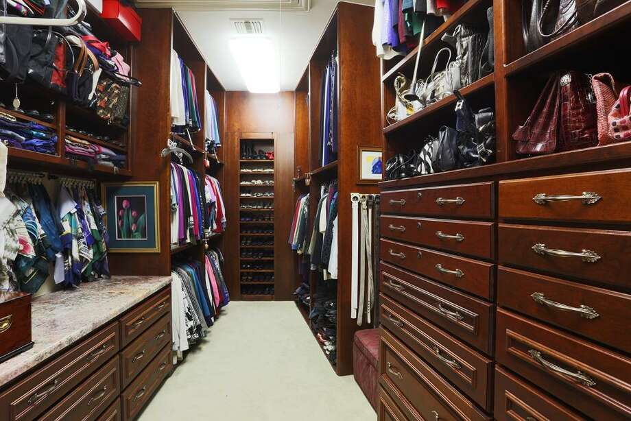 This is one of 2 spacious custom designed closets in the downstairs master.