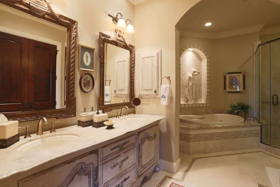 This exquisite bath compares to the downstairs master bath & goes with bedroom # 3.