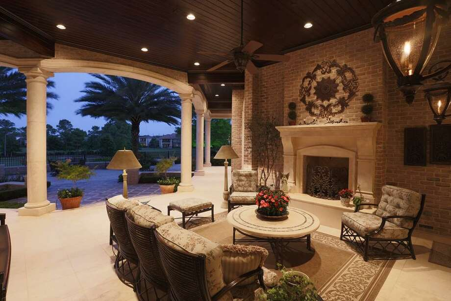 The Pavilion with another beautiful fireplace overlooks the lake with the island green on this 6th signature hole of ROCC.