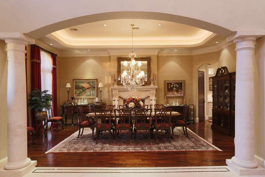 Formal Dining Room has cherry hardwood floors & measures 24x16. Custom coffered ceiling with embedded lighting, plus an exquisite chandelier.