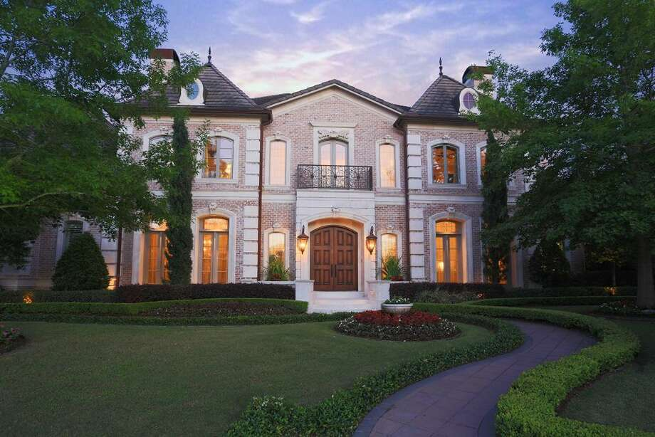 Elegant custom home designed for entertaining. & located in the gated Estate section of Royal Oaks over looking the Fred Couples Signature Golf Course.