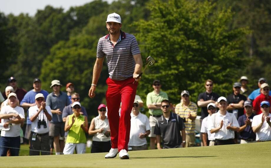 CROMWELL, CT - JUNE 21:  Keegan Bradley reacts to his birdie on the 11th hole during the second round of the Travelers Championship held at TPC River Highlands on June 21, 2013 in Cromwell, Connecticut.  (Photo by Michael Cohen/Getty Images)