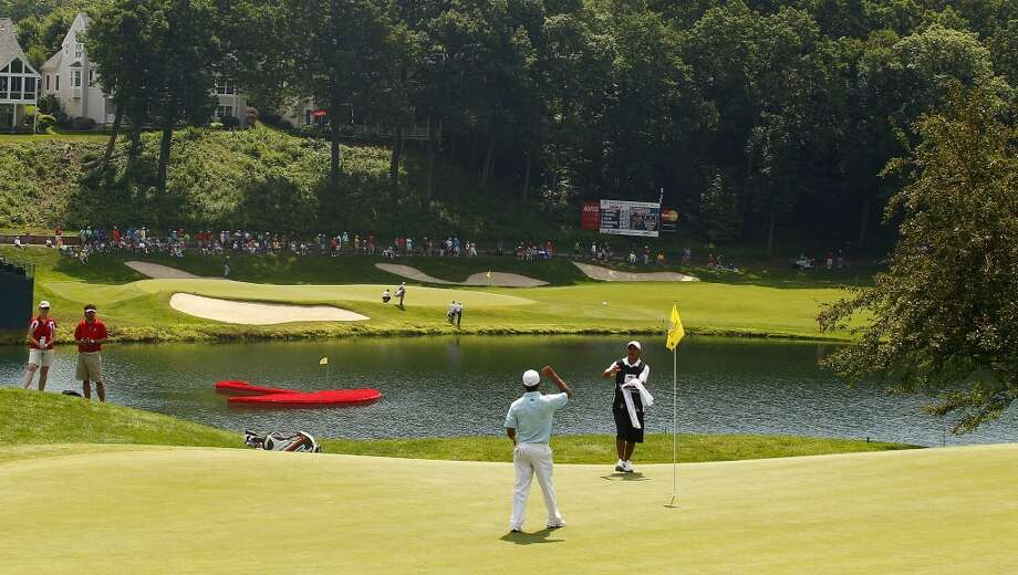 CROMWELL, CT - JUNE 21:  A general view of the first green (foreground) with the 15th green beyond during the second round of the Travelers Championship held at TPC River Highlands on June 21, 2013 in Cromwell, Connecticut.  (Photo by Michael Cohen/Getty Images)