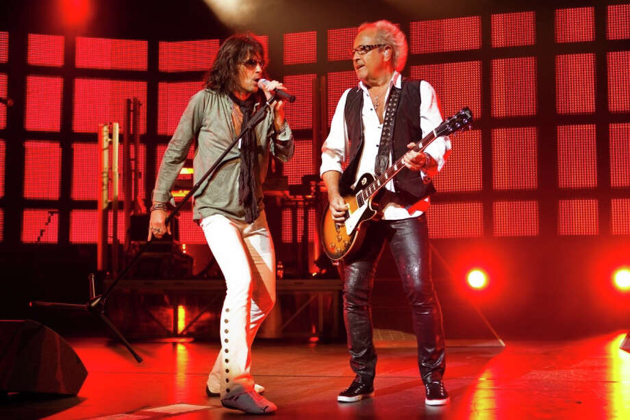 The iconic British-American band Foreigner will rock Westport June 22, 2013. Band founder Mick Jones, right, and lead singer Kelly Hansen, perform at a show last year. The group will take the stage at the Staples High School field house to kick off the Levitt Pavilion for the Performing Arts' summer season. For more information, call 203-221-2153, or visit http://levittpavilion.com. Photo: Contributed Photo / Westport News