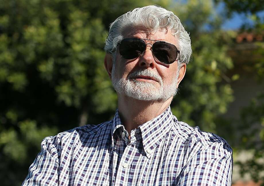 """SAN ANSELMO, CA - JUNE 20:  Film director George Lucas looks on during the unveiling of bronze statues of """"Star Wars"""" character Yoda and Indiana Jones that are displayed at the new Imagination Park on June 20, 2013 in San Anselmo, California. Bronze statues of the """"Star Wars"""" character Yoda and Indiana Jones were unveiled at the new 8,700 square foot Imagination Park in downtown San Anselmo that was donated by """"Star Wars"""" creator and San Anselmo resident George Lucas. Lucas donated the property, paid for park plans and demolition of the existing structures.  (Photo by Justin Sullivan/Getty Images) Photo: Justin Sullivan, Getty Images"""