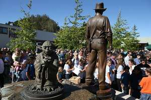 "SAN ANSELMO, CA - JUNE 20:  Bronze statues of ""Star Wars"" character Yoda and Indiana Jones are displayed at the new Imagination Park on June 20, 2013 in San Anselmo, California. Bronze statues of the ""Star Wars"" character Yoda and Indiana Jones were unveiled at the new 8,700 square foot Imagination Park in downtown San Anselmo that was donated by ""Star Wars"" creator and San Anselmo resident George Lucas. Lucas donated the property, paid for park plans and demolition of the existing structures.  (Photo by Justin Sullivan/Getty Images)"