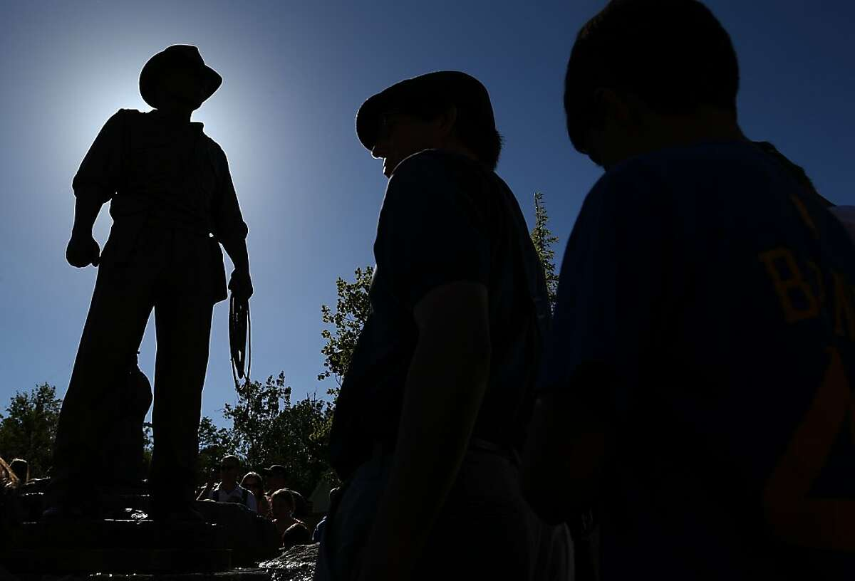 SAN ANSELMO, CA - JUNE 20: A bronze statue of Indiana Jones is displayed at the new Imagination Park on June 20, 2013 in San Anselmo, California. Bronze statues of the