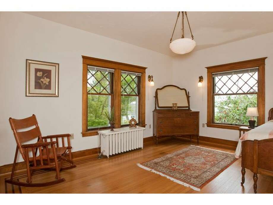 Bedroom of 120 Prospect St., in Queen Anne. The 5,890-square-foot Georgian Colonial, built in 1904, has six bedrooms, four  bathrooms, a big foyer, birch millwork, leaded glass, a den, a sun porch, a White House-like balcony, a roof deck, a carriage house, a greenhouse, a trout pond with a waterfall, and views of downtown Seattle, Mount Rainier, Elliott Bay and Puget Sound on a 10,200-square-foot lot. It's listed for $1.695 million. Photo: Courtesy Mark Dagg, Windermere Real Estate