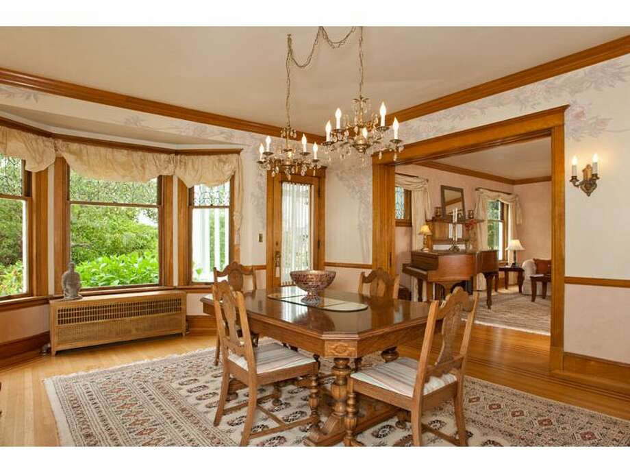 Dining room of 120 Prospect St., in Queen Anne. The 5,890-square-foot Georgian Colonial, built in 1904, has six bedrooms, four  bathrooms, a big foyer, birch millwork, leaded glass, a den, a sun porch, a White House-like balcony, a roof deck, a carriage house, a greenhouse, a trout pond with a waterfall, and views of downtown Seattle, Mount Rainier, Elliott Bay and Puget Sound on a 10,200-square-foot lot. It's listed for $1.695 million. Photo: Courtesy Mark Dagg, Windermere Real Estate