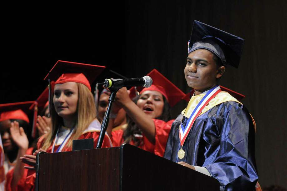 Redal Ram gives his salutatorian address during Schenectady High School's graduation commencement at Proctors Theater on Friday June 21, 2013 in Schenectady, N.Y. (Michael P. Farrell/Times Union) Photo: Michael P. Farrell