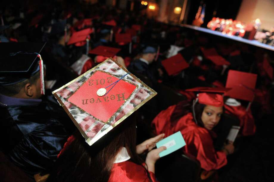 Graduate Heaven Decker wears her personalized graduation cap during Schenectady High School's graduation commencement at Proctors Theater on Friday June 21, 2013 in Schenectady, N.Y. (Michael P. Farrell/Times Union) Photo: Michael P. Farrell