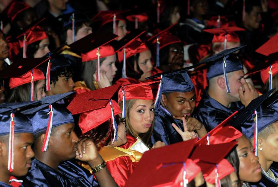 Graduates listen to speakers during Schenectady High School's graduation commencement at Proctors Theater on Friday June 21, 2013 in Schenectady, N.Y. (Michael P. Farrell/Times Union) Photo: Michael P. Farrell