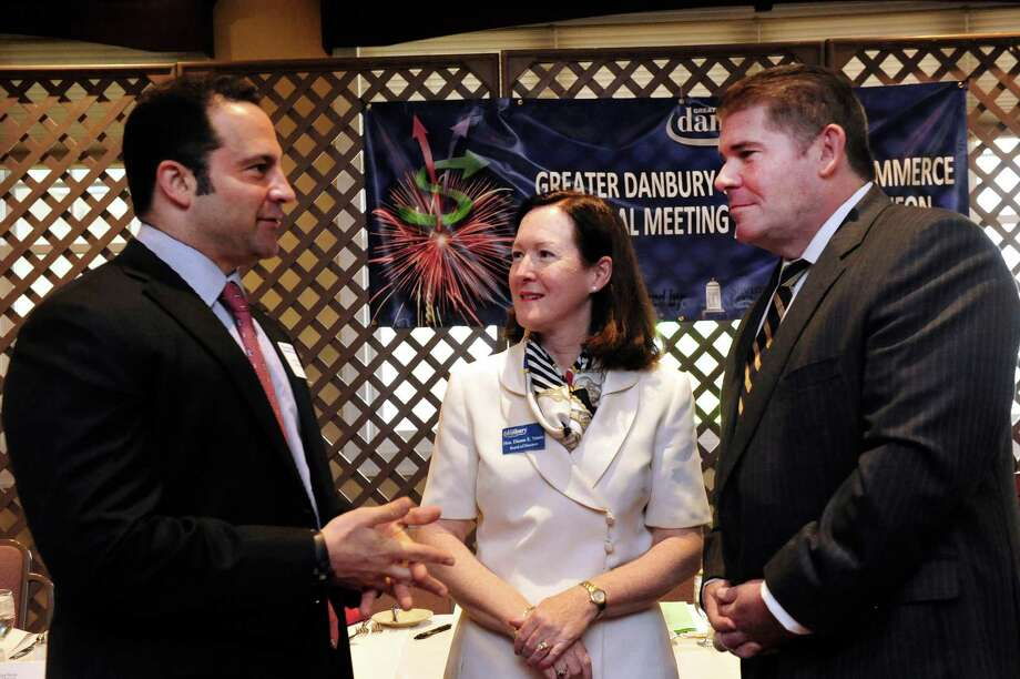 Keynote speaker James Frischling, left, talks with Dianne Yamin, chairman of the board of the Greater Danbury Chamber of Commerce, and Chamber president Stephen Bull at the group's 2013 Annual Meeting Leaders Luncheon on Friday, June 21, 2013 at the Amber Room Colonnade in Danbury, Conn. Photo: Michael Duffy / The News-Times