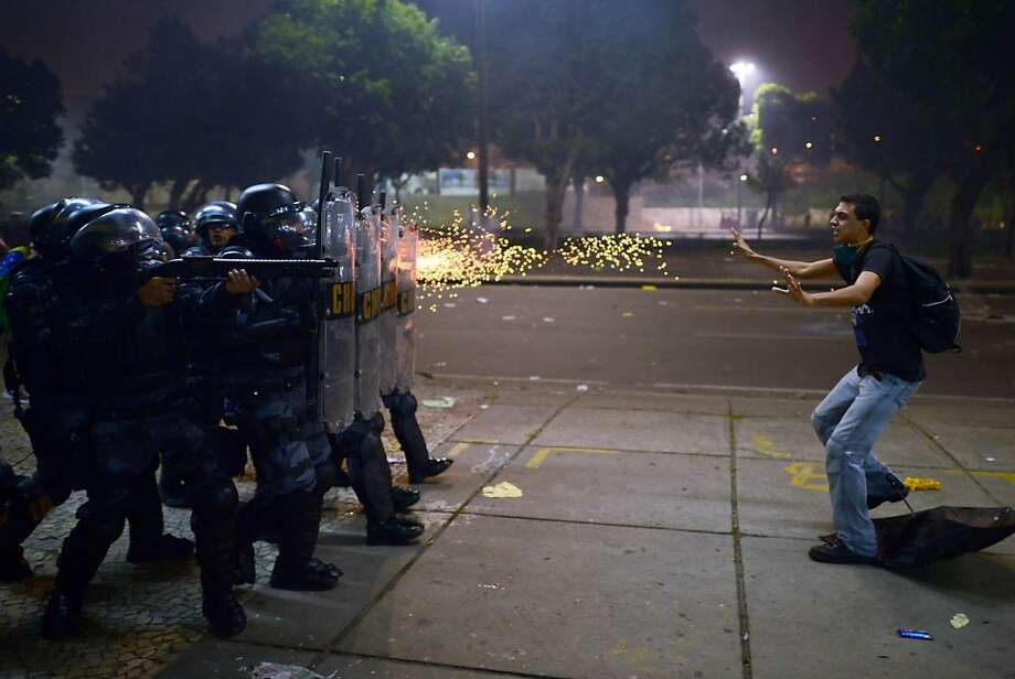Almost like a firing squad, riot police shoot rubber bullets point-blank at a demonstrator in Rio de Janeiro. Photo: Christophe Simon, AFP/Getty Images