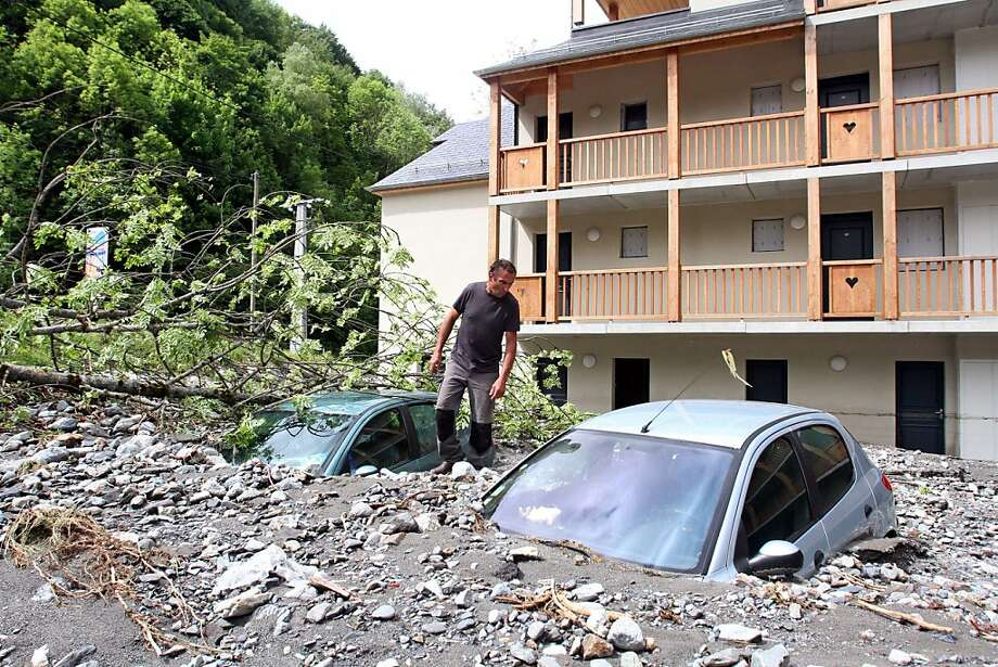 Park and wrecked: Two cars lie buried in mud and debris in Bareges, France, two days after unseasonal storms caused flooding across huge swaths of the country. Photo: Laurent Dard, AFP/Getty Images