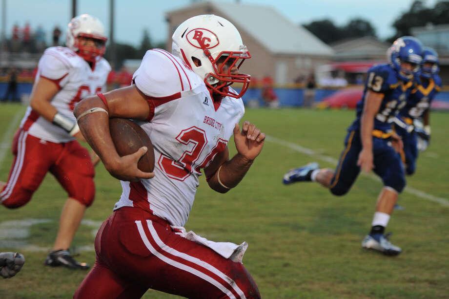 Bridge City Cardinals Ashton Hunter, 34, is makes a run for it against the Kelly Bulldogs. Photo Courtesy Drew Loker/Special to The Enterprise. Photo: Drew Loker / 2012