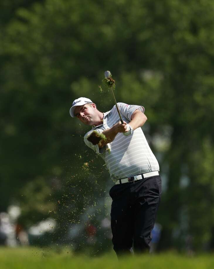 CROMWELL, CT - JUNE 21: Marc Leishman, the defending  champion, hits a shot from the rough during the second round of the Travelers Championship held at TPC River Highlands on June 21, 2013 in Cromwell, Connecticut.  (Photo by Michael Cohen/Getty Images)