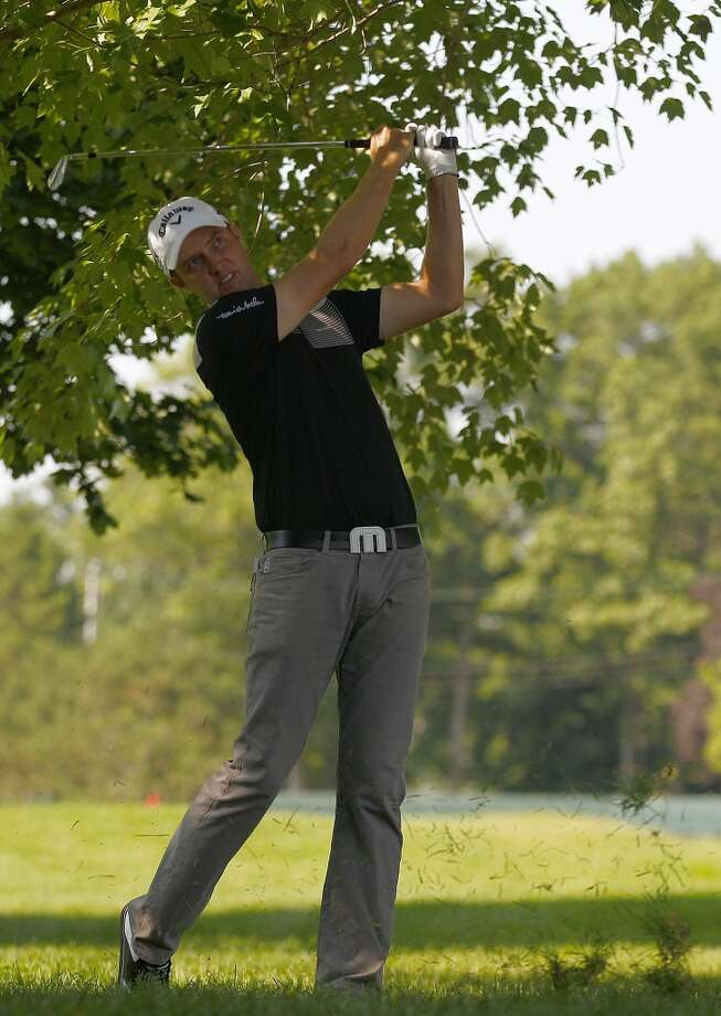 CROMWELL, CT - JUNE 21:  Chris Kirk hits a shot from the rough during the second round of the Travelers Championship held at TPC River Highlands on June 21, 2013 in Cromwell, Connecticut.  (Photo by Michael Cohen/Getty Images)