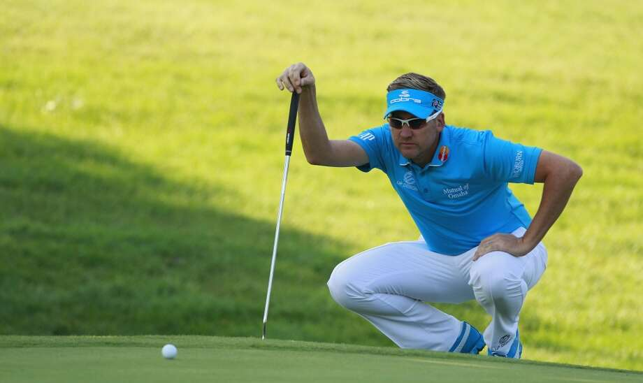CROMWELL, CT - JUNE 21:  Ian Poulter of England lines up a putt during the second round of the Travelers Championship held at TPC River Highlands on June 21, 2013 in Cromwell, Connecticut.  (Photo by Michael Cohen/Getty Images)