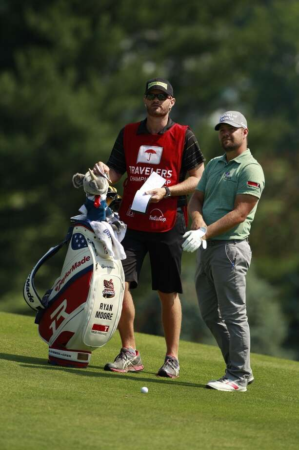 CROMWELL, CT - JUNE 21:  Ryan Moore prepares to hit a shot from the fairway during the second round of the Travelers Championship held at TPC River Highlands on June 21, 2013 in Cromwell, Connecticut.  (Photo by Michael Cohen/Getty Images)