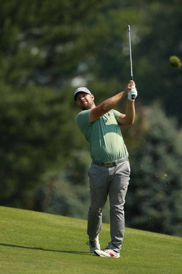 CROMWELL, CT - JUNE 21:  Ryan Moore hits a shot from the fairway during the second round of the Travelers Championship held at TPC River Highlands on June 21, 2013 in Cromwell, Connecticut.  (Photo by Michael Cohen/Getty Images)