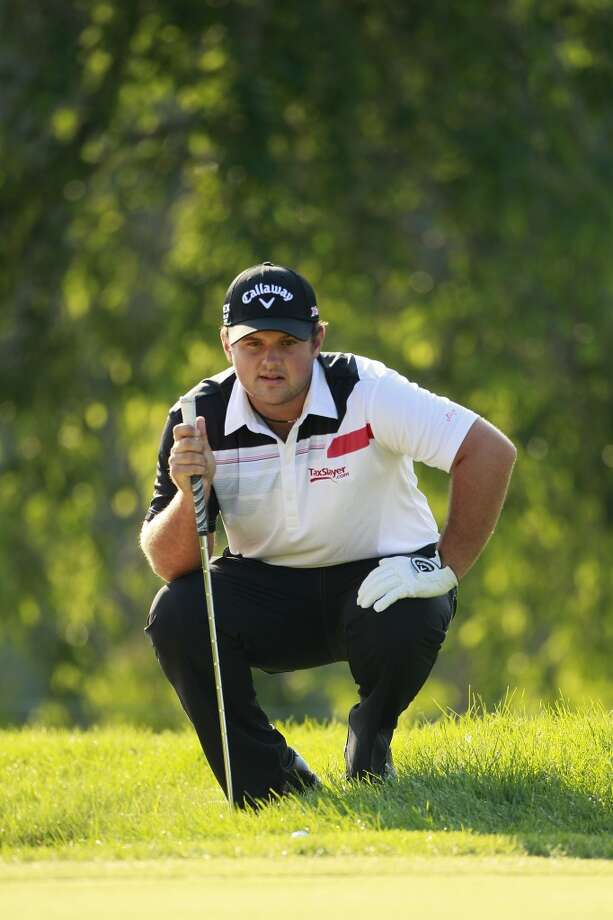 CROMWELL, CT - JUNE 21:  Patrick Reed  lines up a chip shot during the second round of the Travelers Championship held at TPC River Highlands on June 21, 2013 in Cromwell, Connecticut.  (Photo by Michael Cohen/Getty Images)