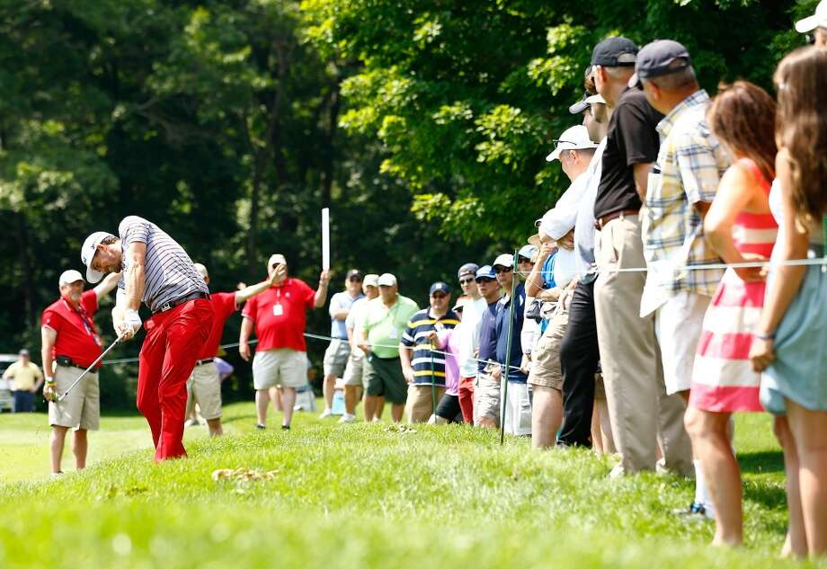CROMWELL, CT- JUNE 21: Keegan Bradley takes his second shot from the rough during the second round of the 2013 Travelers Championship at TPC River Highlands on June 21, 2012 in Cromwell, Connecticut.  (Photo by Jared Wickerham/Getty Images)