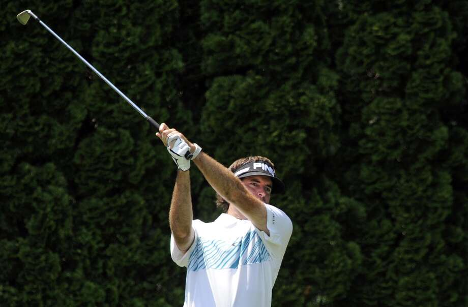 Bubba Watson watches his tee shot on the ninth hole during the second round of the Travelers Championship golf tournament in Cromwell, Conn., Friday, June 21, 2013. Watson shot a 3-under par 67 in his round, to go 10-under par for the tournament. (AP Photo/Fred Beckham)