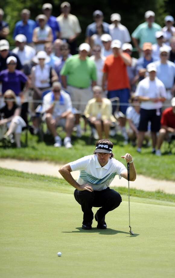 Bubba Watson reads his putt on the ninth green during the second round of the Travelers Championship golf tournament in Cromwell, Conn., Friday, June 21, 2013. Watson shot a 3-under par 67 in his round, to go 10-under par for the tournament. (AP Photo/Fred Beckham)