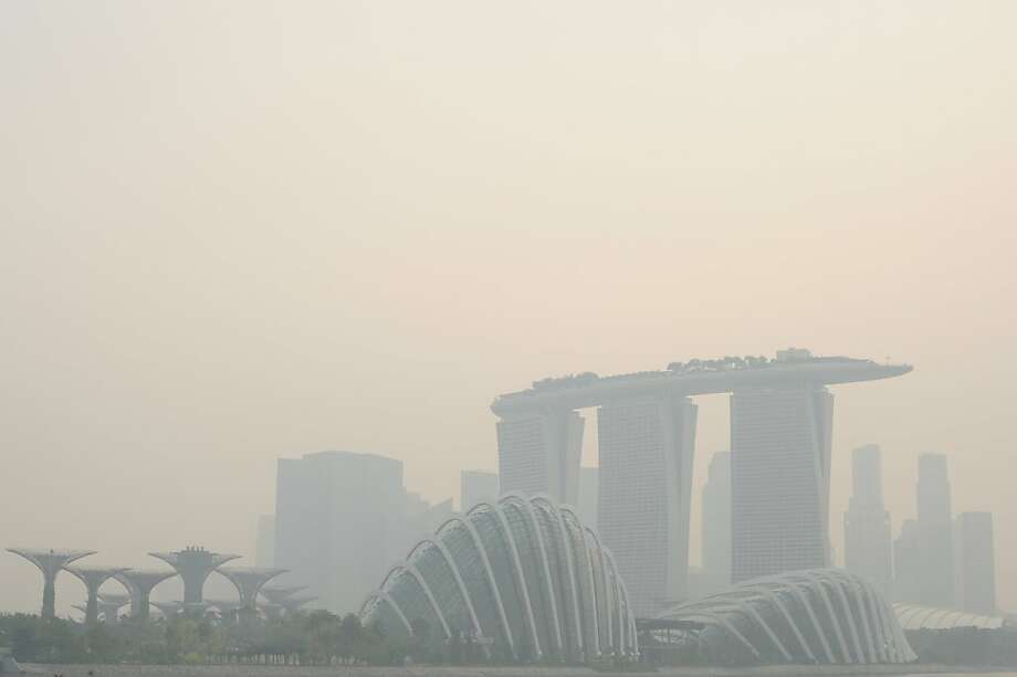 Singapore suddenly looks a lot like Beijing:Air pollution levels reach record heights for the third straight day in  Singapore. Wildfires are blamed for the dangerous smoky haze. Photo: Joseph Nair, Associated Press