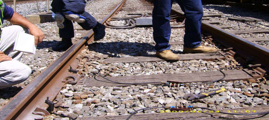 A photo from a powerpoint presentation shows a shunt system on a railroad track. U.S. Senator Richard Blumenthal (D-Conn.) announced today that Metro-North Railroad will implement a pilot program to install shunting devices on portions of its New Haven Line. Photo: Contributed Photo