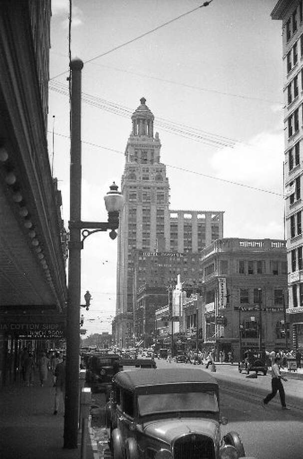 A 1936 street scene with the Niels Esperson Building in the background.