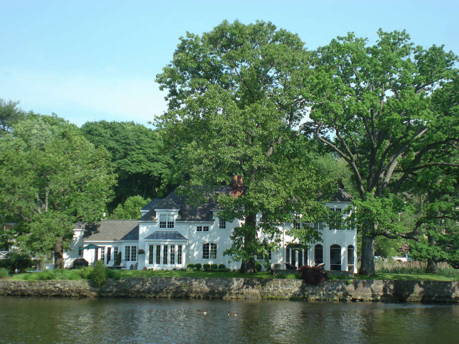 The Mediterrean-style home at 87 Goodwives River Road in Darien, on the market for $4,250,000, overlooks Gorham's Pond. Photo: Contributed
