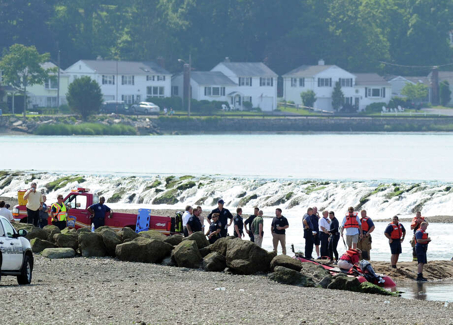 Emergency personnel search for a possible drowning victim in the water off Weed Beach in Darien, Friday afternoon, June 21, 2013. Photo: Bob Luckey / Greenwich Time