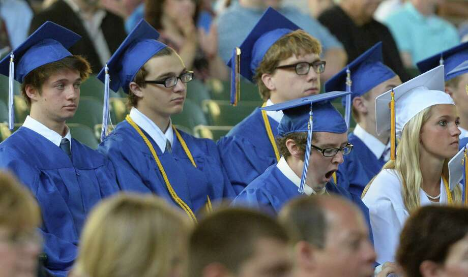 A big yawn by one of the  480 Saratoga High School students to graduate today during the ceremony held at the Saratoga Performing Arts Center June 21, 2013 in Saratoga Springs, N.Y.   (Skip Dickstein/Times Union) Photo: SKIP DICKSTEIN / 10022848A