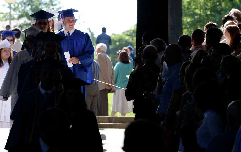 A procession of over 480 Saratoga High School students moves down the isle during graduation ceremony held at the Saratoga Performing Arts Center June 21, 2013 in Saratoga Springs, N.Y.   (Skip Dickstein/Times Union) Photo: SKIP DICKSTEIN / 10022848A