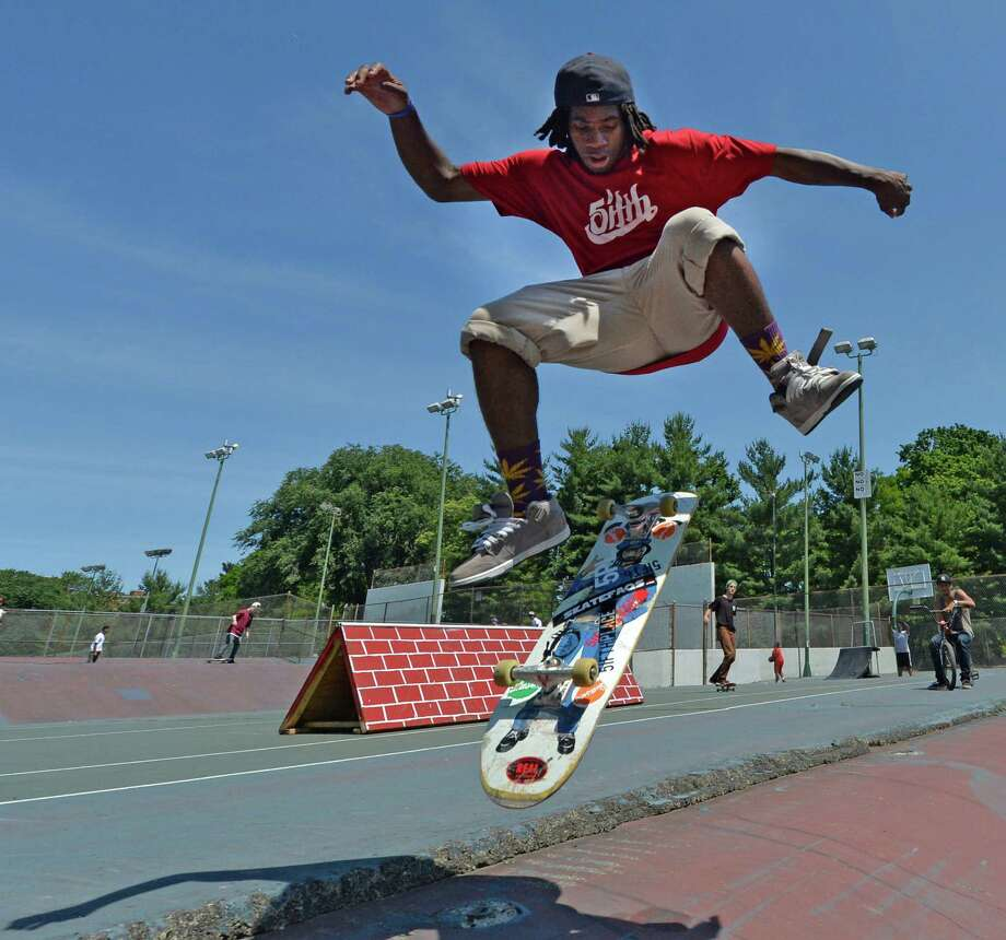 Yafay Towles, 17, of Watervliet gets air in the Washington Park tennis courts during National Go Skateboarding Day June 21, 2013 in Albany, N.Y.     (Skip Dickstein/Times Union) Photo: SKIP DICKSTEIN / 00022923A