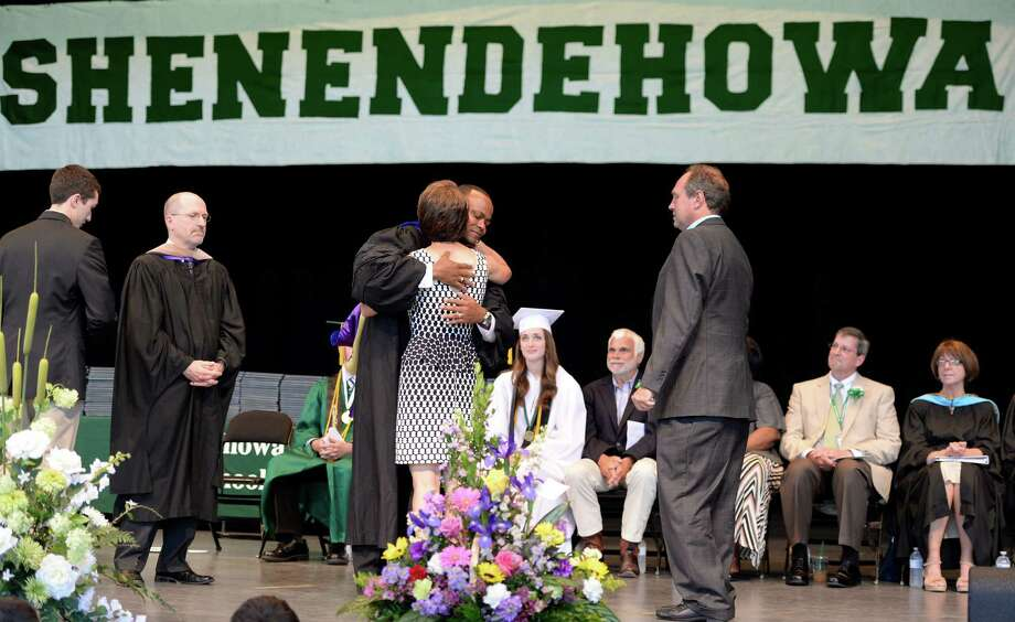 The family of  crash victim Chris Stewart is warmly greeted by Oliver Robinson, Shenendehowa superintendent, during the commencement ceremony held at the Saratoga Performing Arts Center June 21, 2013 in Saratoga Springs, N.Y.   (Skip Dickstein/Times Union) Photo: SKIP DICKSTEIN / 10022849A