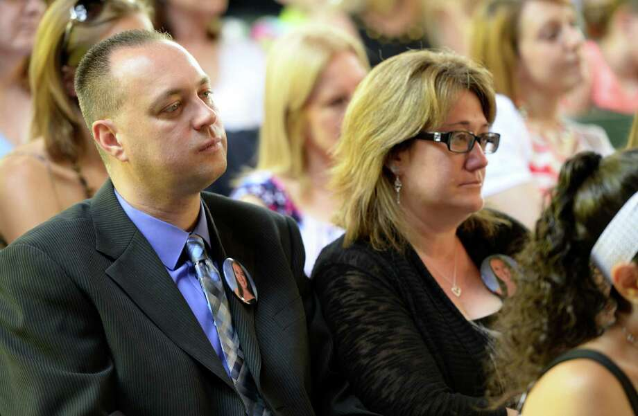 Deanna Rivers' parents, Brian and Deborah Rivers, attend the Shenendehowa High School commencement ceremony held at the Saratoga Performing Arts Center June 21, 2013 in Saratoga Springs, N.Y.  They received their daughter's diploma at a brief ceremony at the beginning of the commencement. (Skip Dickstein/Times Union) Photo: SKIP DICKSTEIN / 10022849A
