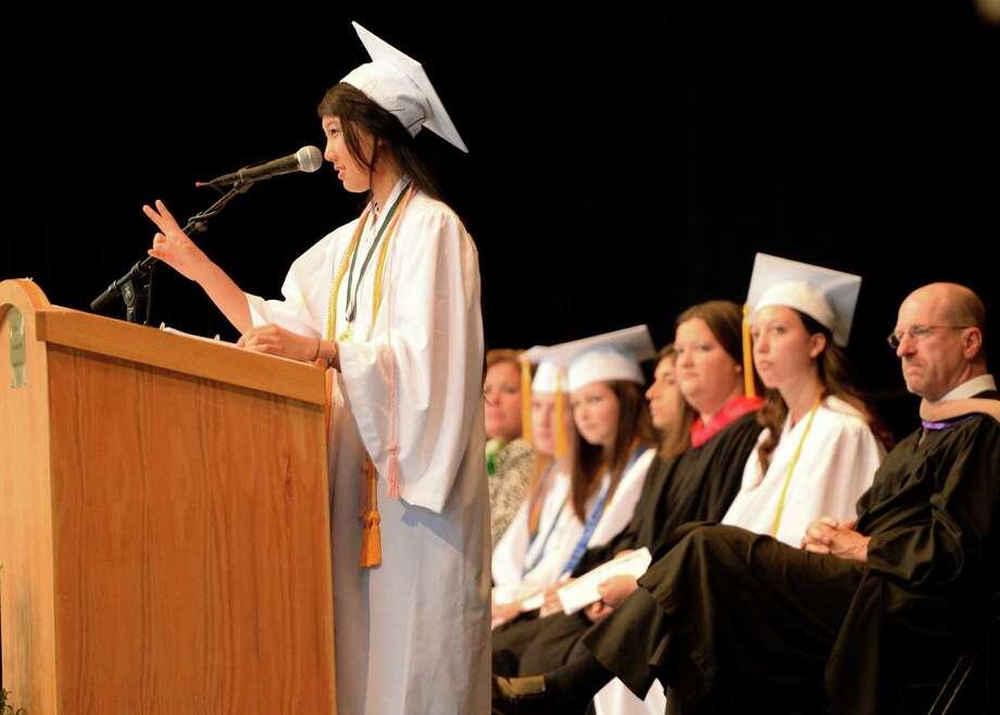 Valedictorian Sarah Yang gives her valedictory speech during the Shenendehowa High School commencement ceremony held at the Saratoga Performing Arts Center June 21, 2013, in Saratoga Springs, N.Y.   (Skip Dickstein/Times Union) Photo: SKIP DICKSTEIN / 10022849A