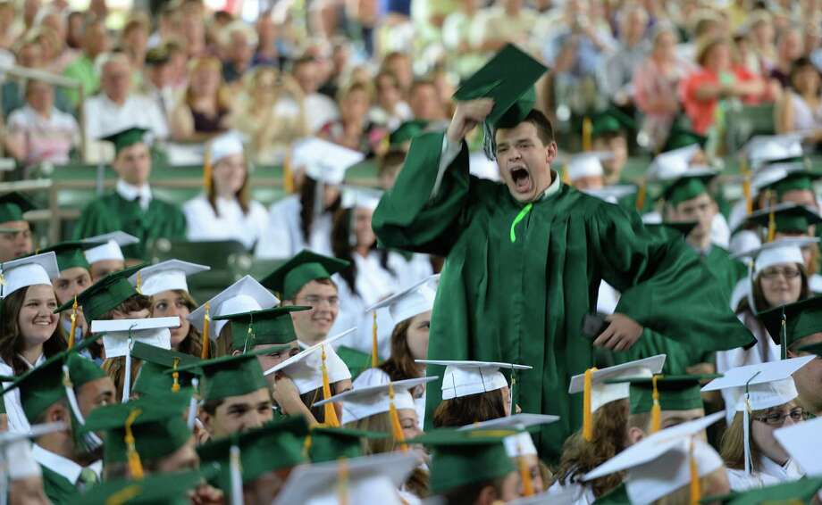 Samuel Holcomb fires up his classmates during the Shenendehowa High School commencement ceremony held at the Saratoga Performing Arts Center June 21, 2013 in Saratoga Springs, N.Y.   (Skip Dickstein/Times Union) Photo: SKIP DICKSTEIN / 10022849A