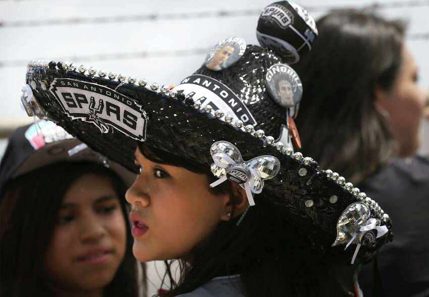 San Antonio Spurs fan Juliabell Castillon wears her Spurs sombrero as she waits for the team to arrive at the San Antonio International Airport on Friday, June, 21, 2013.