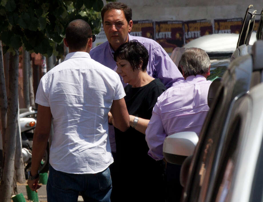 Actor James Gandolfini's sister Leta Gandolfini, at center in black, arrives with unidentified people at the morgue of the Policlinico Umberto I hospital where the body of Gandolfini is kept, in Rome, Friday, June 21, 2013. James Gandolfini died Wednesday night after suffering a cardiac arrest while vacationing with friends and relatives in Rome. (AP Photo/Alessandra Tarantino) Photo: Alessandra Tarantino
