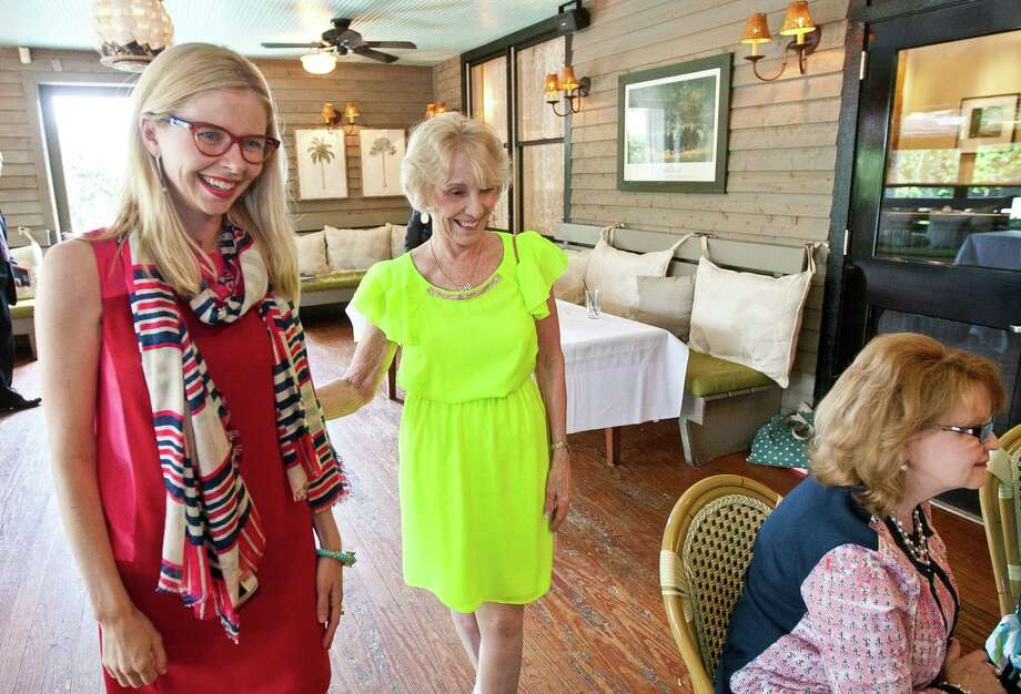 "Lily Koppel, left, author of ""The Astronaut Wives Club,"" and Sue Bean were part of a gathering last week at Ouisie's Table for a book-signing/reunion/tea party of wives of former astronauts.  Photo: Nick De La Torre, Staff / © 2013  Houston Chronicle"